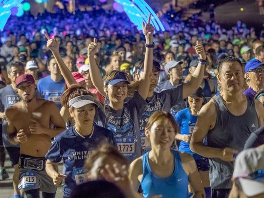 Half-marathon runners cheer at the starting line of the 2018 United Airlines Guam Marathon.