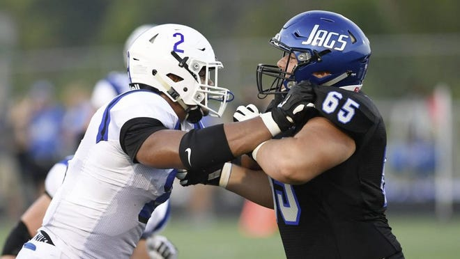Hilliard Bradley's David Metzler (right) blocks Hilliard Davidson's Gage Key during a game last season. Hilliard City Schools on July 29 announced the suspension of all extracurricular activities until further notice amid the COVID-19 coronavirus pandemic.