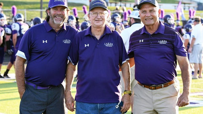 Camdenton's Wayne Burch (center) poses with Head Coach Jeff Shore (left) and former coach Bob Shore (right) at a Laker football game. Burch will be honored as part of the Missouri Sports Hall of Fame's 'Elite 11'  on October 20.
