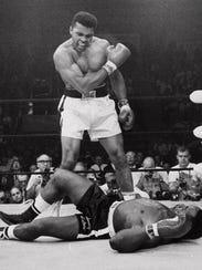Muhammad Ali stands over fallen challenger Sonny Liston