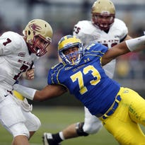 Delaware defensive lineman Blaine Woodson (right) tries to tackle Elon quarterback Mike Quinn last season at Delaware Stadium. Woodson set a UD freshmen record with 8.5 sacks last year. His 0.71 sacks per game led all freshmen nationally in NCAA FCS.
