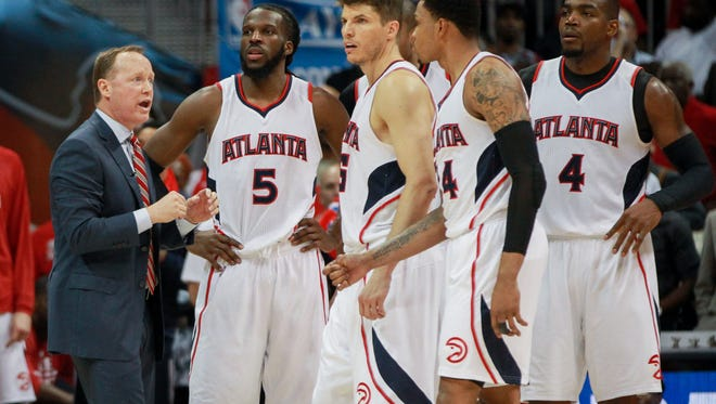 Atlanta Hawks head coach Mike Budenholzer talks with players during the fourth quarter of game two of the first round of the NBA Playoffs against the Brooklyn Nets at Philips Arena in Atalanta on April 22, 2015. The Hawks won 96-91.