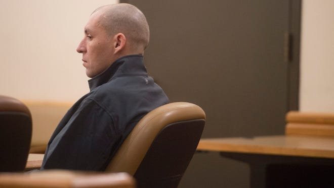 Joseph Giaquinto sits in the courtroom before sentencing at the Larimer County Justice Center on Thursday, January 4, 2018. Giaquinto was sentenced to wellness court and work release for charges of felony criminal mischief and a bias-motivated crime after he vandalized the Fort Collins Islamic Center in March 2017.
