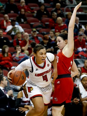 WKU's Jaycee Coe gets called for the foul as Louisville's Mariya Moore tries to drive around her. Dec. 11, 2016