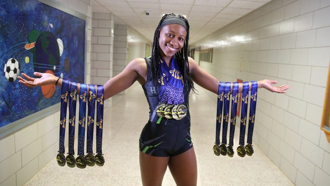 Lanae-Tava Thomas, a senior at Rush-Henrietta, is the AGR Girls Indoor Track and Field Athlete of the Year. Thomas is holding just some of the state medals she has won over the course of her high school career.  So far, it is 48 and counting, for both indoor and outdoor track.