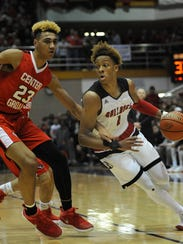 New Albany's Romeo Langford (right) drives against