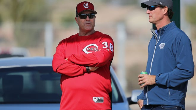 Cincinnati Reds manager Bryan Price (38), left, talks with general manager Dick Williams, right, Saturday, Feb. 17, 2018, at the Cincinnati Reds Spring Training facility in Goodyear, Arizona.