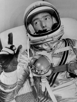 Astronaut Scott Carpenter gestures after donning his space suit in Hangar S prior to being shot into orbit at Cape Canaveral, Fla., May 24, 1962.