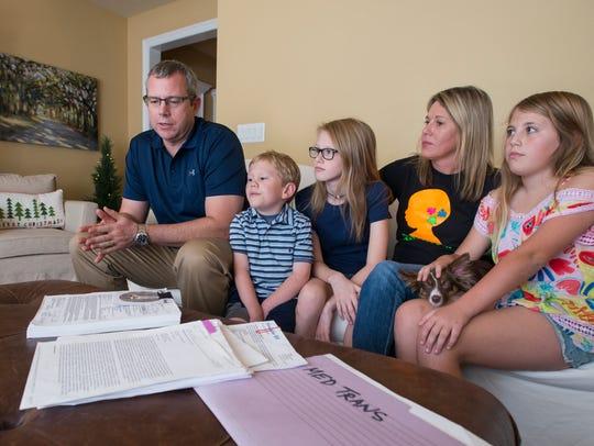 The Jones family listens as Kevin Jones, left, talks