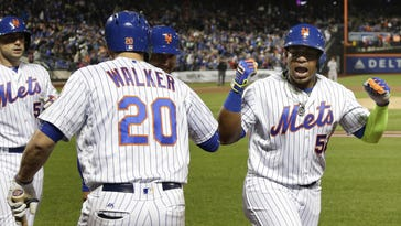 The Mets' Yoenis Cespedes reacts after hitting a grand slam against the San Francisco Giants during the third inning of Friday night's game at Citi Field.