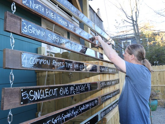 Owner Martijn Mollet adds a beer to the menu in the