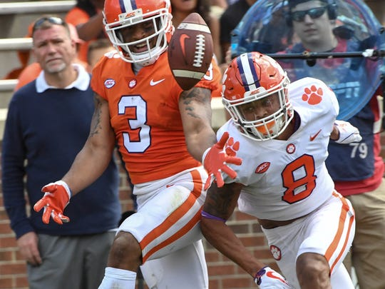 Clemson wide receiver Amari Rodgers (3) and Clemson defensive back A.J. Terrell (8) reach for a loose ball during the 3rd quarter of the spring game in Memorial Stadium in Clemson on Saturday, April 14, 2018.
