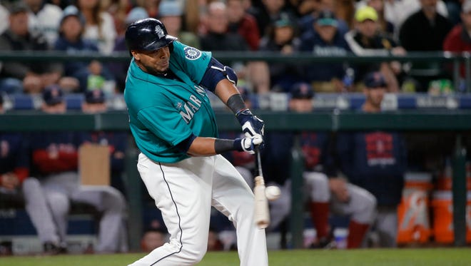 Seattle Mariners' Nelson Cruz hits a walk-off RBI single in the ninth inning of a baseball game against Boston Red Sox, Friday, May 15, 2015, in Seattle. The Mariners defeated the Red Sox 2-1.