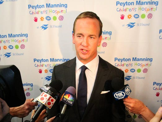 Peyton Manning answers questions from the gathered press during a brief presser at FedX Hangar before the annual Peyton Manning's 7th Annual Children's Hospital Fundraising Gala, Saturday, April 26, 2014.
