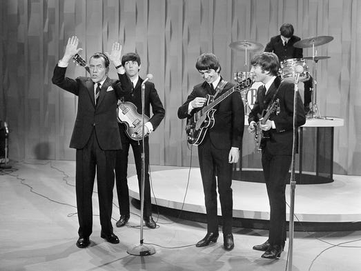 "Paul McCartney, George Harrison, John Lennon and Ringo Starr perform during their first appearance on ""The Ed Sullivan Show"" on Feb. 9, 1964."