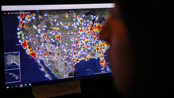 A U.S. map at the National Human Trafficking Hotline call center shows trafficking cases reported in 2016. As of December 2017, the hotline will have been operating in its current form for 10 years.