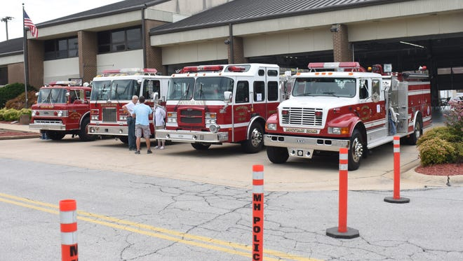 Firetrucks sit outside of Fire Station No. 1 on Saturday morning.