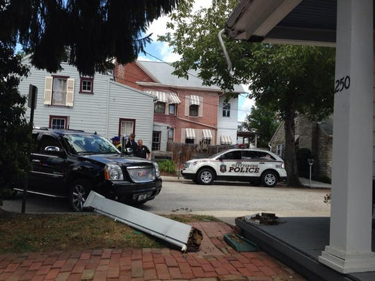 A person driving a black SUV crashes into porch in Gettysburg on Wednesday afternoon.