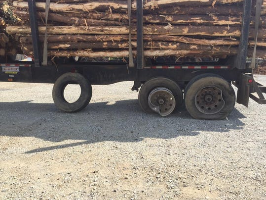 A tractor-trail has a flat tire and busted rim following a crash in Mount Joy Township on Thursday afternoon.