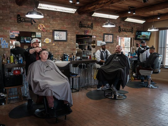Cheeky Chaps Barber Shop is a spacious comfortable place to have a hair-cut. Manager and master barber Chris Marangos, left, master barber Armando Lopez, and master barber Daniel Padilla sharpen the look of customers at the shop on a recent Friday.
