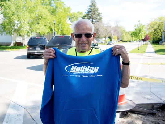 636637092341726014-Crossing-guard-Jerry-Boehlen-with-Holiday-Automotive-sweatshirt-May-2018.jpg