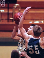 Darrin Charles played basketball for Oshkosh North