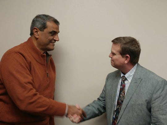 Dr. Ahmed Mattar, medical director of the Wichita Falls Family Practice Residency Program, and Community Healthcare Center Executive Director Allen Patterson seal a deal in which both programs will benefit from working together to meet the medical needs of the community.