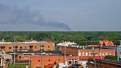 A dark plume of smoke comes from where a U.S. Air Force