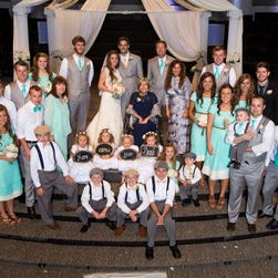 The Duggar and Dillard families at wedding in June 2014 in Springdale, Ark.