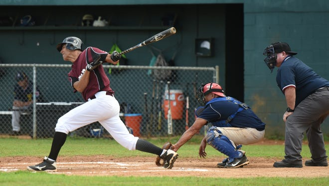 In this July 14 file photo, 7 Day Supermarket Nationals' Mike Cooper-Nurse swings at a low pitch during a 2018 Guam Masters Baseball League game against the MTM Falcons at Paseo Stadium. Both teams will play make-up games on Saturday.