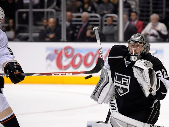 Los Angeles Kings goalie Jonathan Quick, right, stops a shot by Anaheim Ducks left wing Matt Beleskey during the first period in Game 3 of an NHL hockey second-round Stanley Cup playoff series, Thursday, May 8, 2014, in Los Angeles. (AP Photo/Mark J. Terrill)