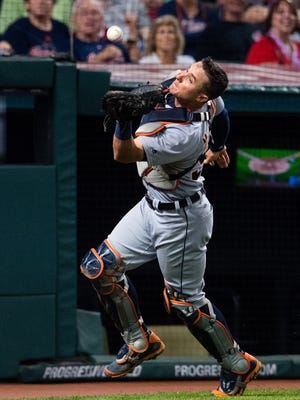 Tigers catcher James McCann catches a pop fly hit by Indians rightfielder Michael Martinez to end the eighth inning of the Tigers' 11-4 loss to the Indians Friday in Cleveland.