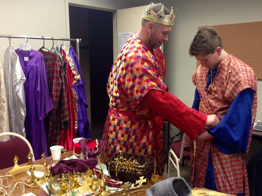 Fred Ruggles and son Myer, 13, put on their costumes to play two of the three wise men in First United Methodist Church's live nativity on Sunday.