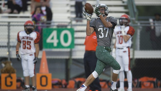 Fossil Ridge wide receiver Donovan Murphree catches a pass in a game earlier this season. The SaberCats host Denver East at 7 p.m. Friday.