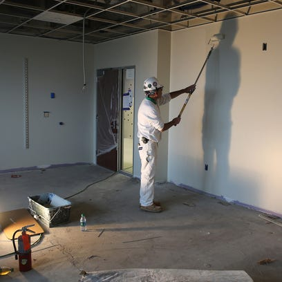 Workers finishing up in community room at School 12.