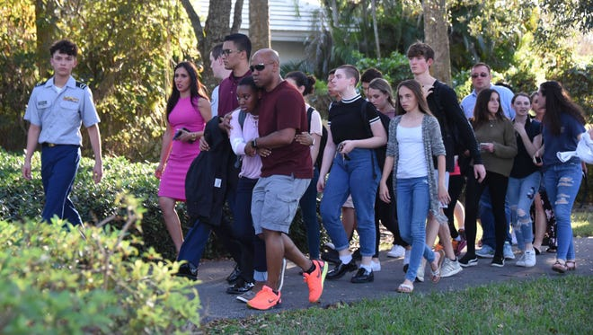 Students leave Marjory Stoneman Douglas High School in Parkland, Fla., on Feb. 14, 2018.