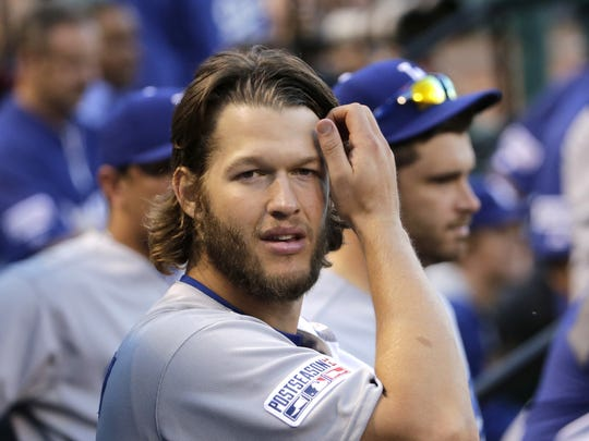 Los Angeles Dodgers starting pitcher Clayton Kershaw looks on in the dugout during the sixth inning in Game 4 of baseball's NL Division Series against the St. Louis Cardinals, Tuesday, Oct. 7, 2014, in St. Louis. (AP Photo/Charles Rex Arbogast)