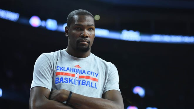 Mar 29, 2016; Oklahoma City Thunder forward Kevin Durant (35) watches from the bench during the fourth quarter against the Detroit Pistons at The Palace of Auburn Hills.