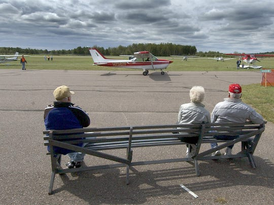 In this 2006 file photo, spectators watch as airplanes pass by for take-off during the Merrill Airport Day at the Merrill Municipal Airport.
