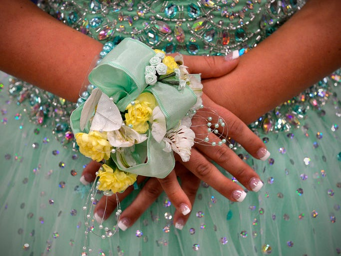 Junior Michaela Johnson shows off her matching corsage during prom at Foley High School.