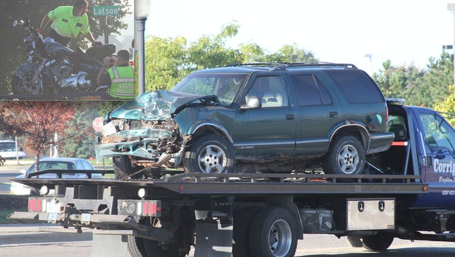 Steven Mark Kelty, the driver of the 1997 Chevrolet TrailBlazer, was on trial in Livingston County Circuit Court for causing the September 2014 crash that killed a Hamburg Township police sergeant who was riding the 2014 Harley Davidson motorcycle (inset) at the intersection of Latson Road and Figurski Drive in Genoa Township.