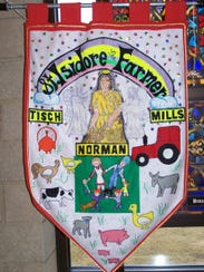 A banner from the Isidore the Farmer parish, representing