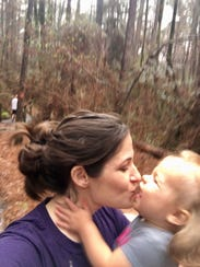 Marie Guidry gives her mom kisses on a trail at North