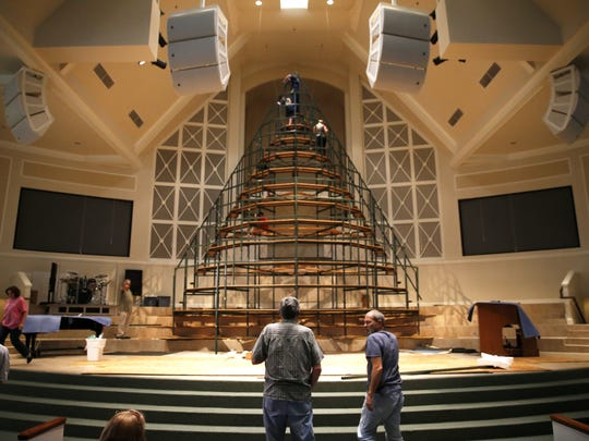 Volunteers work to erect the singing Christmas tree at Bradfordville First Baptist Church Monday. The tree will hold nearly 50 choir members on every level of the 45-foot-tall structure during a Christmas concert series at the church Dec. 11-13.