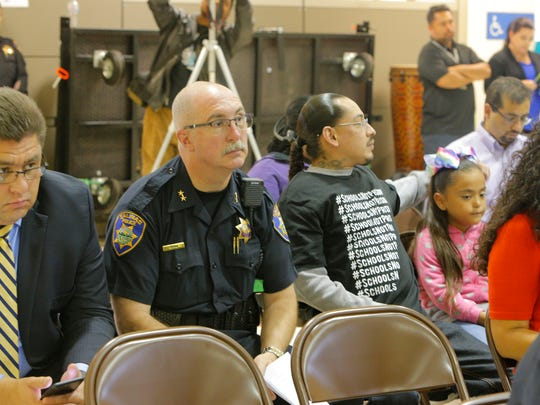 FILE: Supporters and opponents of the school resource officer program sit side-by-side in the audience at the Alisal Union School District in 2017.