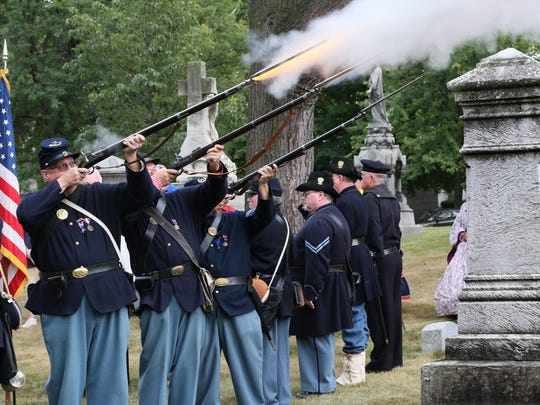 The honor guard fires a salute to Pvt. Charles Blanchard during the ceremony. Local Chapters of Sons of Union Veterans of the Civil War gathered in uniform for a short ceremony on the 75th anniversary of the last Civil War veteran to die in Milwaukee County.  Pvt. Charles Blanchard was 96 when he died in 1942 and is buried in Forest Home Cemetery.
