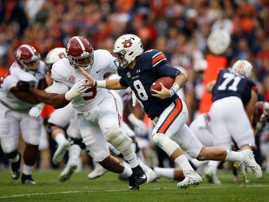 Auburn quarterback Jarrett Stidham (8) runs the ball during the first half of the Iron Bowl NCAA college football game against Alabama, Saturday, Nov. 25, 2017, in Auburn, Ala.