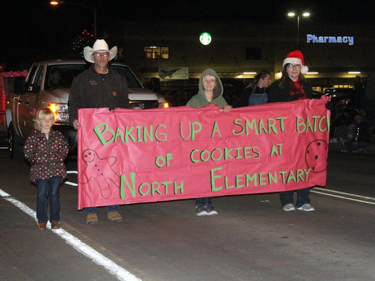 The Alamogordo Christmas Parade had 82 floats while residents packed the curb on 10th Street Saturday.