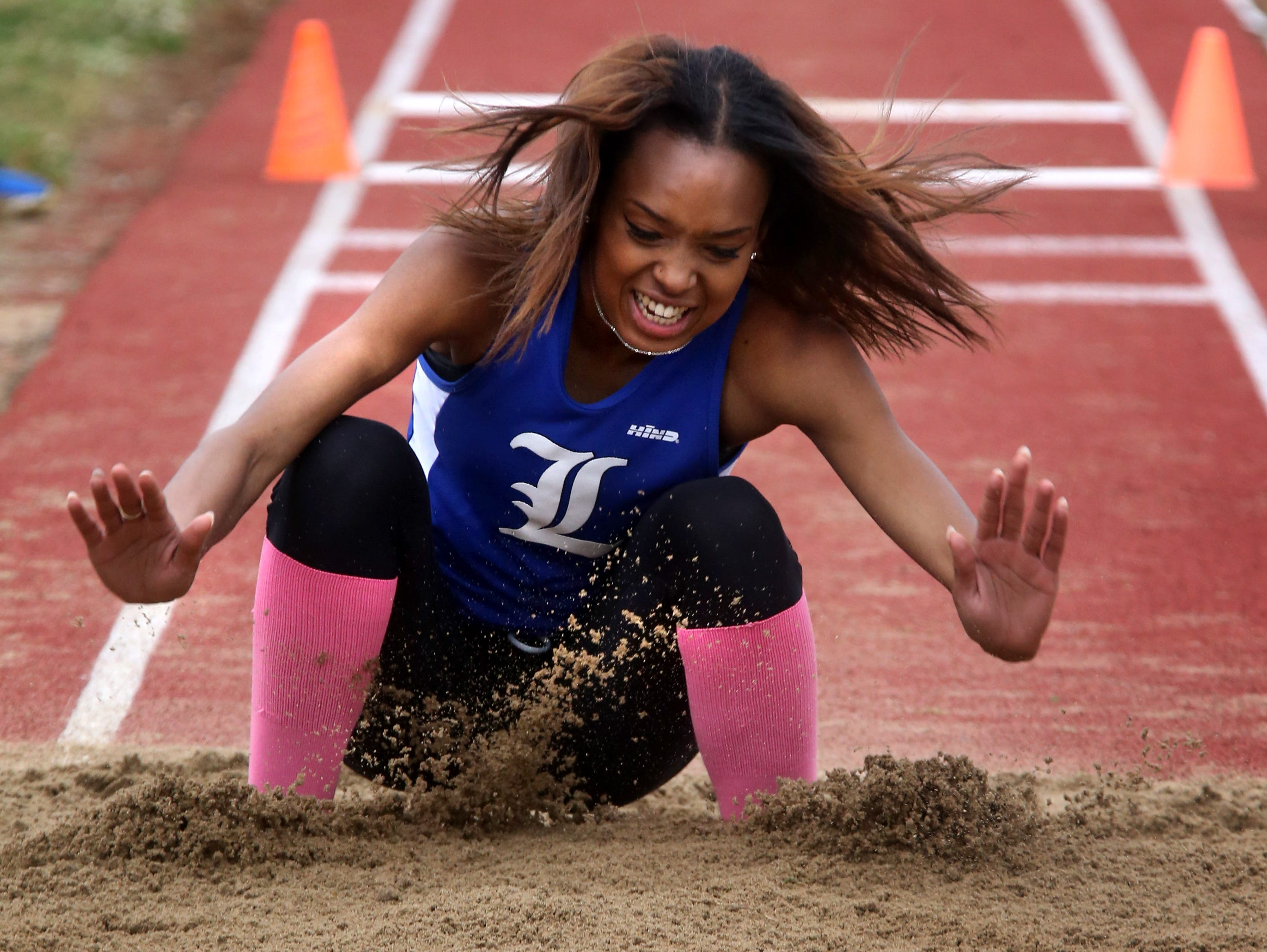 La Vergne's Aliah Cook competes in the girls Class AAA triple jump on Thursday at Spring Fling.