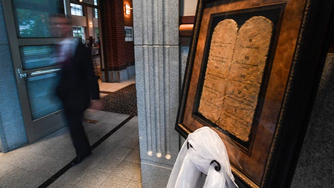 A plaque of the Ten Commandments is in the lobby before the election watch party for U.S. Senate candidate at the Alabama Activity Center in downtown Montgomery, Ala., on Tuesday August 15, 2017.